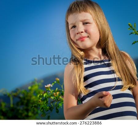 Little girl in field - stock photo