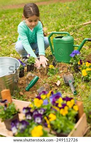 Little girl in garden - stock photo