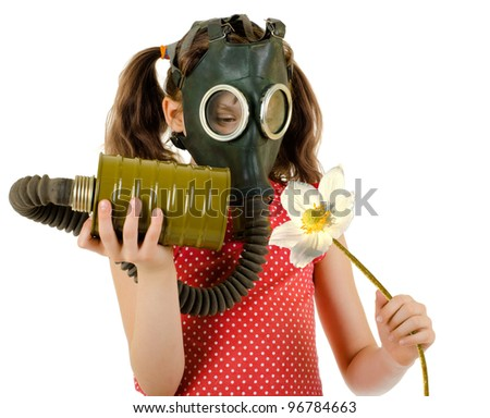 little girl  in gas mask, smell big white flower, on white background, isolated - stock photo