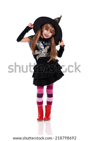 Little girl in halloween costume with black hat, isolated on white background - stock photo