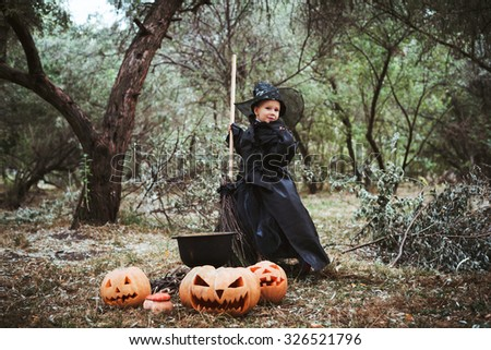 little girl in halloween witch costume