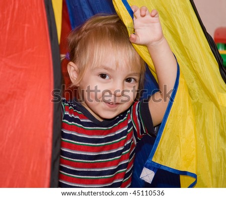 little girl in her colorful tent - stock photo