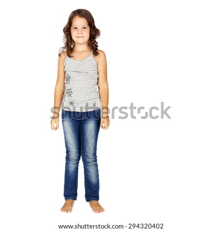 little girl in jeans standing in studio