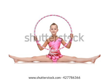 Little girl in pink clothes with hula hoop doing gymnastics - stock photo