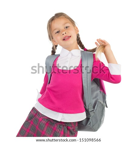 Little girl in pink school uniform with a backpack is having fun with her braid, isolated - stock photo