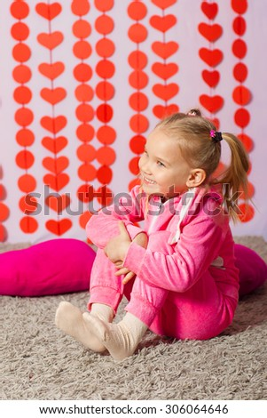 little girl in pink trendy sportswear - stock photo