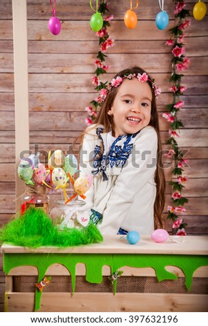 Little girl in popular Romanian costume enjoying the Easter holidays