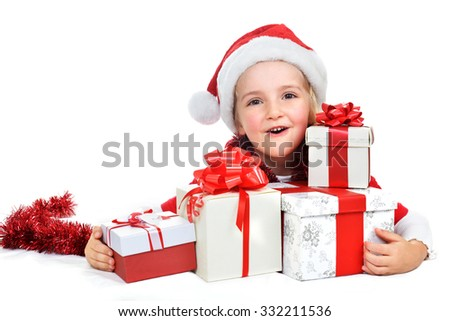 little girl in red santa cap with christmas presents  - stock photo