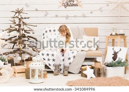 Little girl in scandinavian style christmas decorations - stock photo