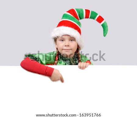 Little girl in suit of Christmas elf with the white board. - stock photo