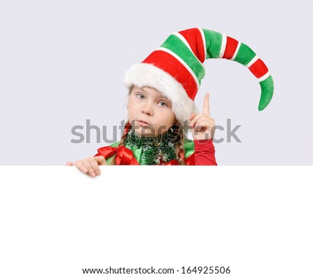 Little girl in suit of Christmas elf with the white board - stock photo