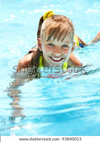 Little girl in swimming pool. Summer outdoor. - stock photo