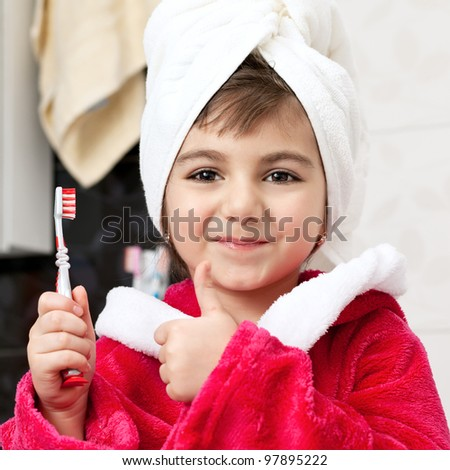 little girl in the bathroom with a toothbrush - stock photo