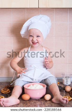little girl in the cook costume - stock photo