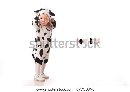 little girl in the cow costume - stock photo