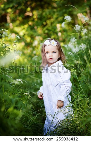 Little girl in the forest
