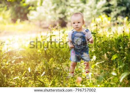 little girl in the forest in the summer