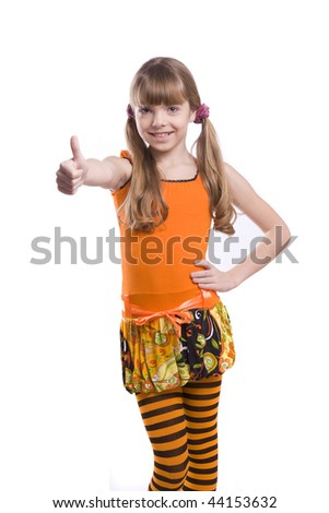 Little girl in the orange dress is showing thumbs up on white background. Portrait of an attractive young teenage rmake gesture ok in orange over white background. - stock photo
