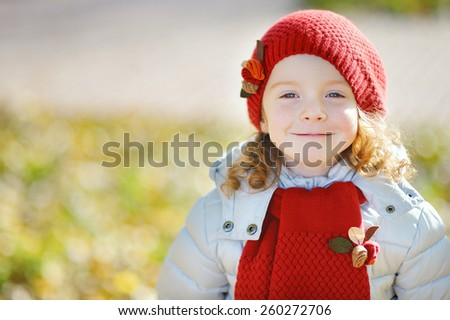 little girl in the park, red cap