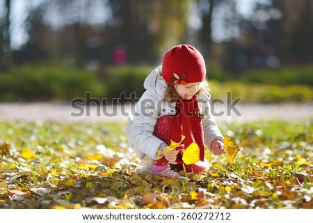 little girl in the park, red cap - stock photo