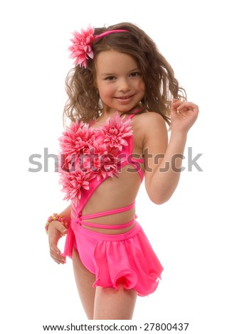 little girl in the pink bathing suit in the flower - stock photo