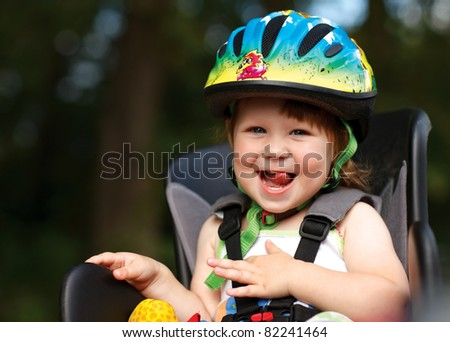 Little girl in the seat bicycle