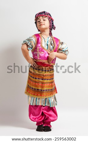 Little girl in traditional Turkish folklore costume - stock photo