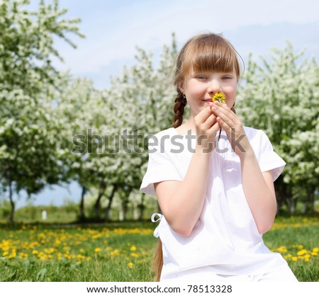 little girl in white clothes in spring park