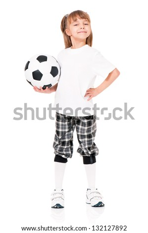 Little girl in white T-shirt with soccer ball, isolated on white background - stock photo
