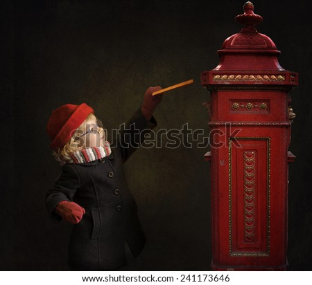 little girl in winter coat and scarf with letter  - stock photo