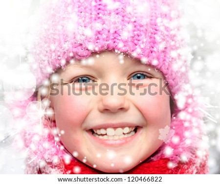 Little girl in winter pink hat in snow forest. - stock photo