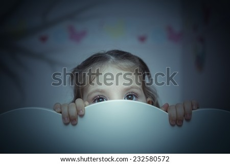 little girl is afraid of shadow of tree - stock photo