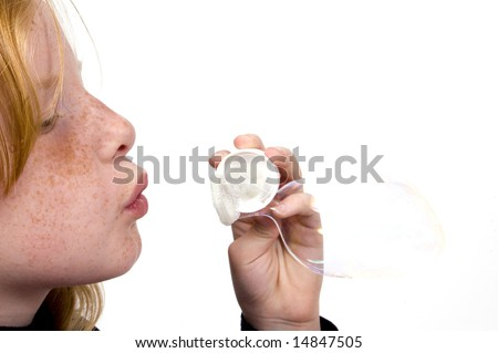 little girl is blowing bubbles isolated on white