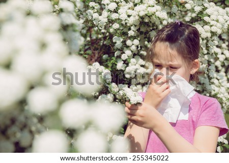 Little girl is blowing her nose, selective focus - stock photo
