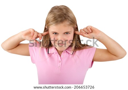 little girl is closing her ears with her fingers - stock photo