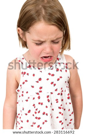 Little girl is crying wearing a white dress isolated on white