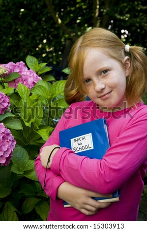 Little girl is going back to school - stock photo