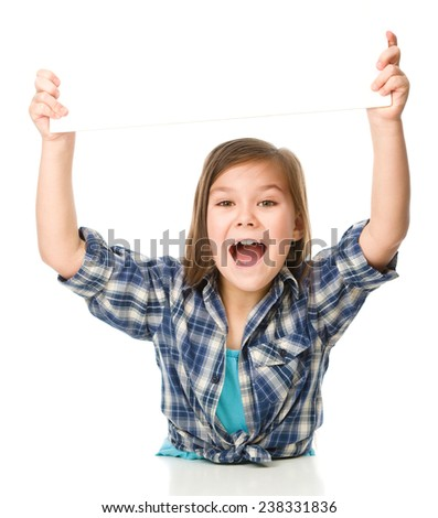 Little girl is holding a blank banner, isolated over white - stock photo