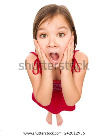 Little girl is holding her face in astonishment and looking up, fisheye portrait, isolated over white - stock photo