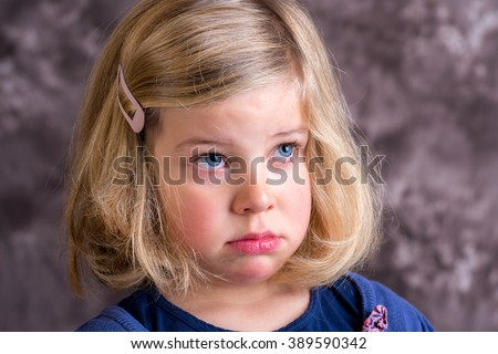 little girl is in bad mood and crying - stock photo