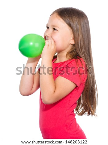 Little girl is inflating green balloon, isolated over white - stock photo