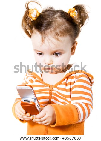 little girl is playing in java game on mobile phone - stock photo