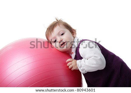 Little girl is playing with fitball isolated on white