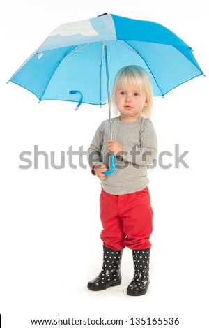 Little girl is posing with a blue umbrella (isolated on white) - stock photo
