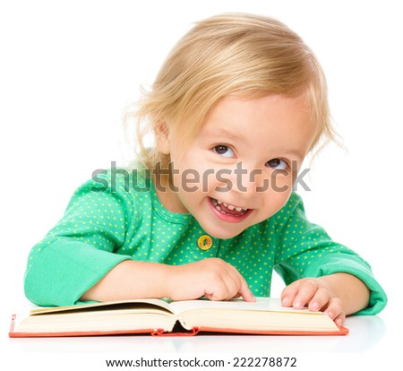 Little girl is reading her book, isolated over white - stock photo