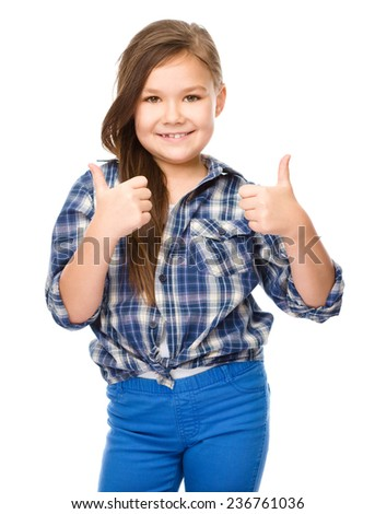 Little girl is showing thumb up gesture using both hands, isolated over white - stock photo