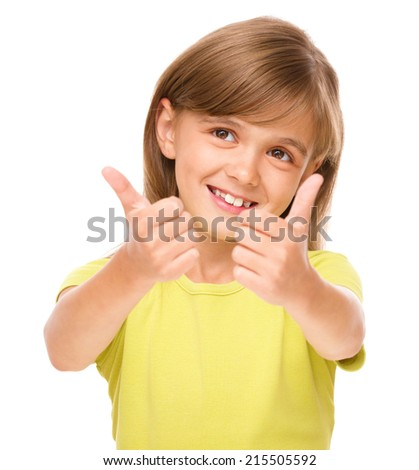 Little girl is showing thumb up sign using both hands, isolated over white - stock photo