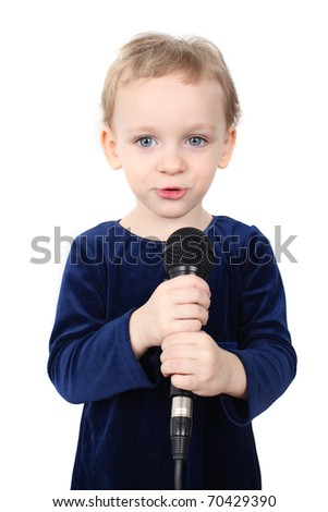 Little girl is singing with a microphone - stock photo