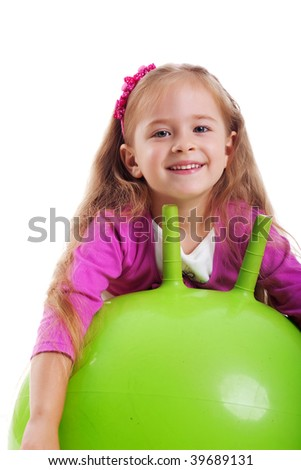 Little girl jump on a big green ball girl on white background - stock photo