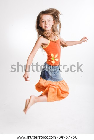 little girl jumping - stock photo